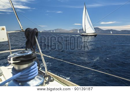Sailboats competitor of sailing regatta in clear sunny weather. Luxury yachts on Mediterranean sea.