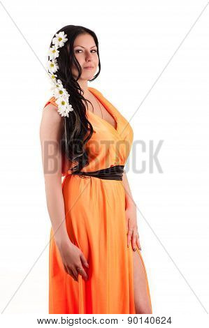 beautiful brunette in orange dress with chrysanthemums