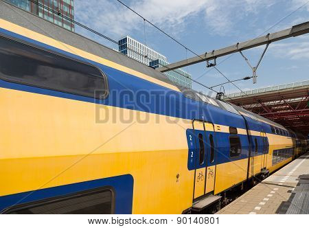 Dutch Double Decker Train Is Leaving A Station