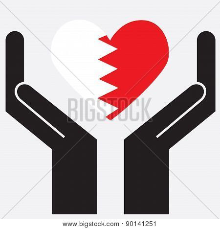 Hand showing Bahrain flag in a heart shape.