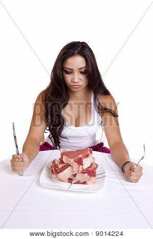 Woman Looking At Steaks