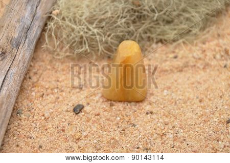 Orange Calcite On Beach
