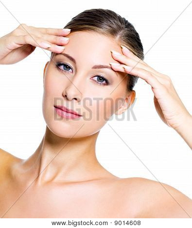 Woman Touching Her Forehead