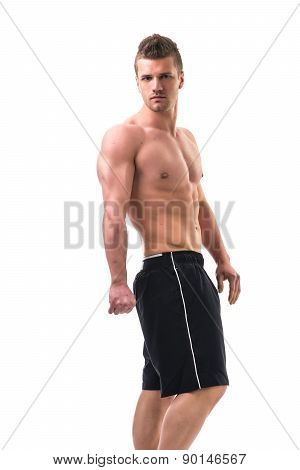 Handsome bodybuilder doing tricep pose, isolated