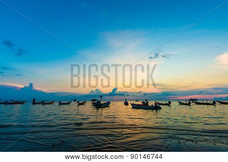Sunset In The Sea Of Tao Island With Boat
