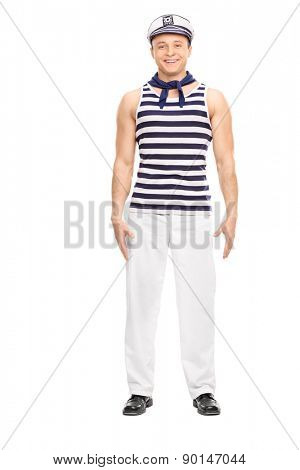 Full length portrait of a young male sailor standing straight and smiling isolated on white background