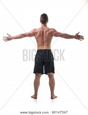 Back of young muscle man shirtless with arms spread open