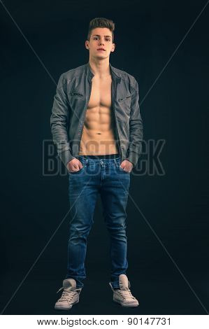 Full length shot of young man wearing jacket on naked torso