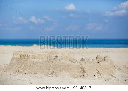 Sand Castle On A Sandy Beach