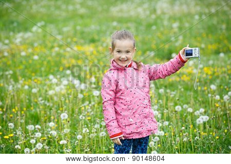 Little Smiling Girl Proudly Showing Her Photograph