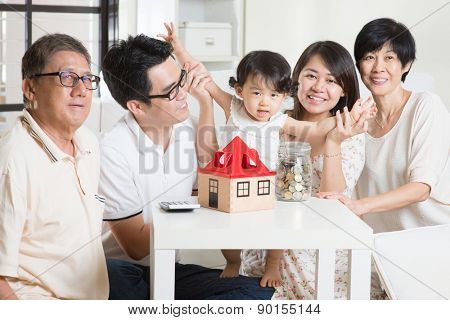 Family money saving or future financial planning concept. Asian multi generations lifestyle at home.