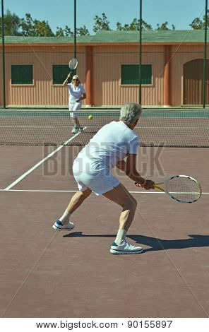 couple on tennis court