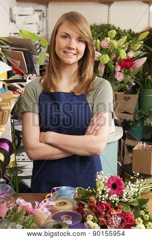 Owner Of Florist Standing In Shop