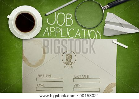 Job application concept on green blackboard with coffee cup