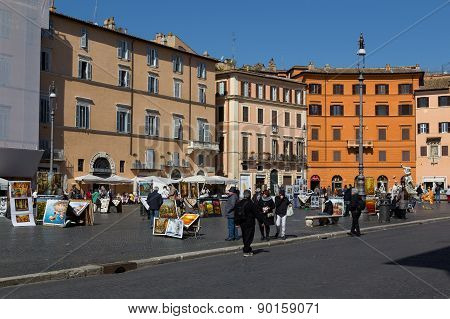 Painters And People In Piazza Navona.