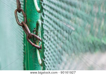 Close Up Chain Locked On Green Color Fence Gate