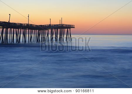 Fishing Pier and Smooth Ocean at Sunrise