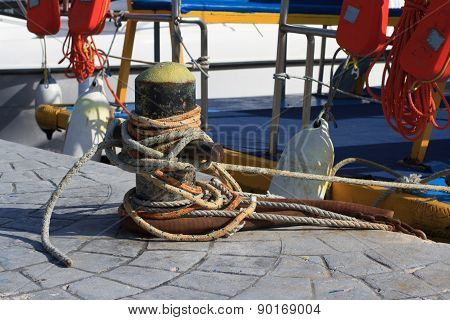 Bollard With Ropes Close-up In The Port