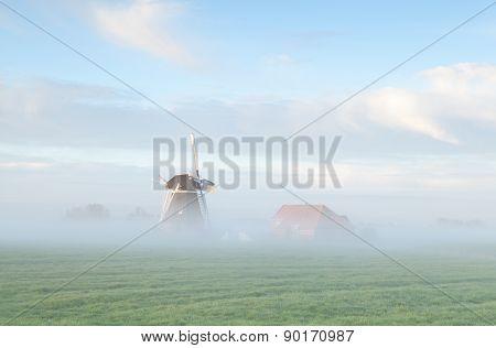 Dutch Windmill In Morning Fog