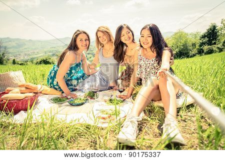 Women Taking Selfie With Stick At Picnic