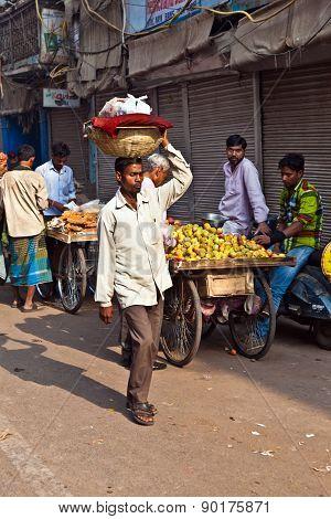 Man Carrying Goods On His Head At Chawri Bazar In Delhi, India