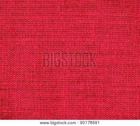 Crimson color burlap texture background
