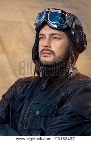 Retro Pilot Portrait with Glasses and Vintage Helmet
