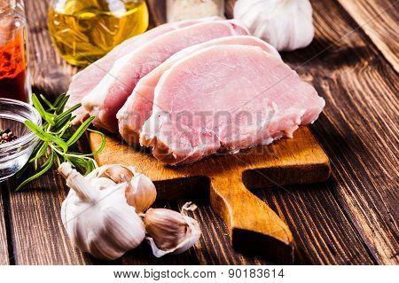 Raw Pork Slices On A Chopping Board