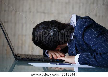 Tired Businesswoman Sleeping On Laptop