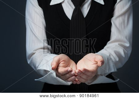 Outstretched Cupped Hands Of Young Woman