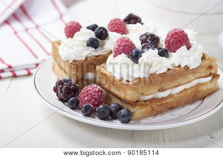 Soft Waffles With Protein Cream And Berries.