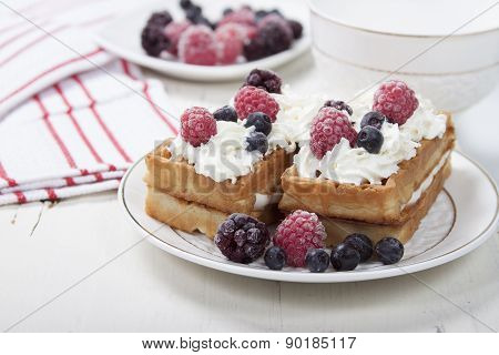 Soft Waffles With Protein Cream, Berry Jam, Whipped Cream And Berries.