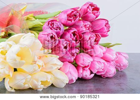 Tulips bouquets on the table