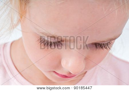 Portrait of cute little girl with long eyelashes