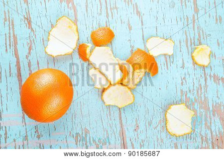 Fresh Sweet Orange Fruit And Peel On Rustic Wood Background