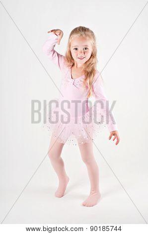 Happy ballet dancing little girl