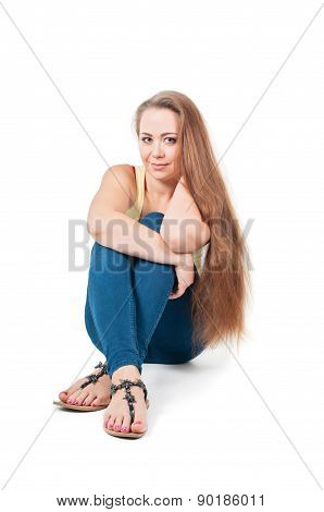 Positive young female sitting on the floor