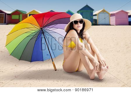 Attractive Model Sitting At Shore