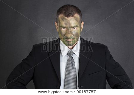 Serious Businessman With Jungle Camouflage Paint