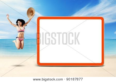 Cheerful Woman Jumps At Coast Near The Board