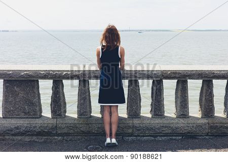 Young Woman Admiring Sea From Promenade