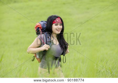 Female Backpacker Walk In Nature