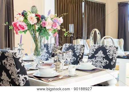 Dining table with decorative flower