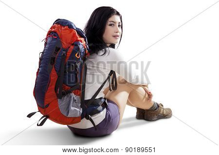 Female Hiker Sitting In The Studio