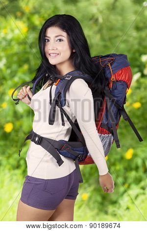 Female Hiker With Backpack In Woods