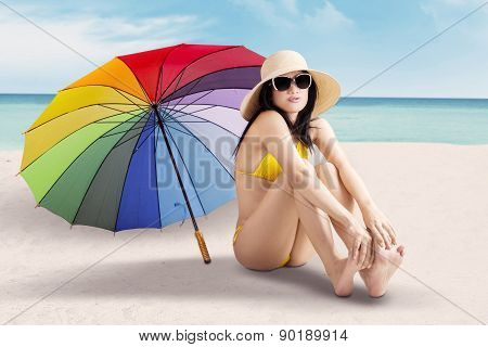 Female Model With Colorful Umbrella At Coast