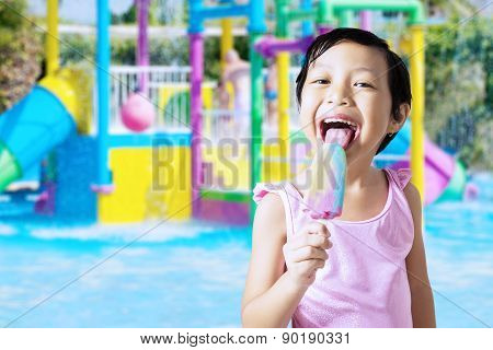 Girl Licking An Ice Cream At Pool