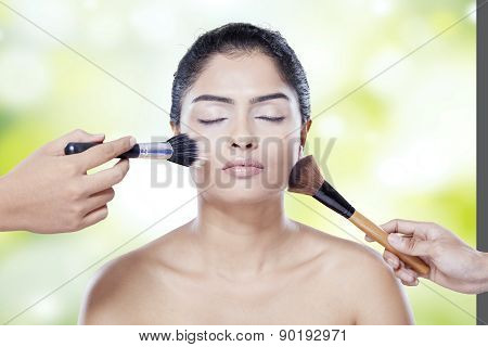 Model Apply Makeup By Her Assistant