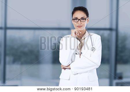 Portrait Of Hispanic Doctor In Hospital