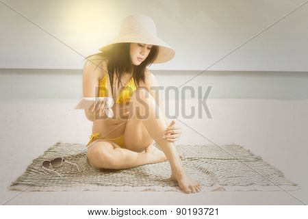 Pretty Woman Applying Sunblock